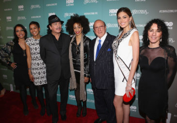 "NEW YORK, NY - APRIL 16:  Lucinda Martinez, Jackie Gagne, Carlos Santana, wife Cindy Blackman Santana, Clive Davis, Gabriela Isler and Shelly Brown attend the HBO Latino NYC Premiere of ""Santana: De Corazon"" at Hudson Theatre on April 16, 2014 in New York City.  (Photo by Jerritt Clark/Getty Images for HBO Latino)"